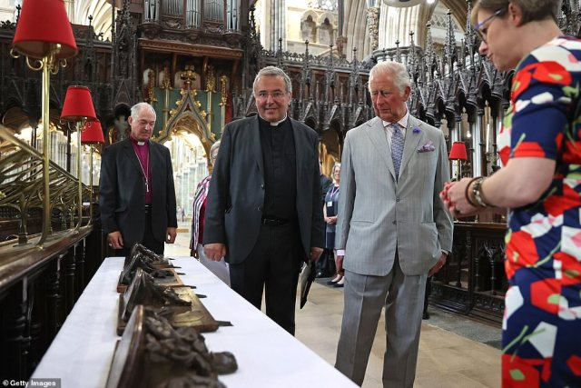 Prince Charles will also launch the new Prince of Wales Nursing Cadet Scheme while in Devon (picturedon a tour of some of the Cathedral's historic treasures by The Very Reverend Jonathan Greener, Dean of Exeter)