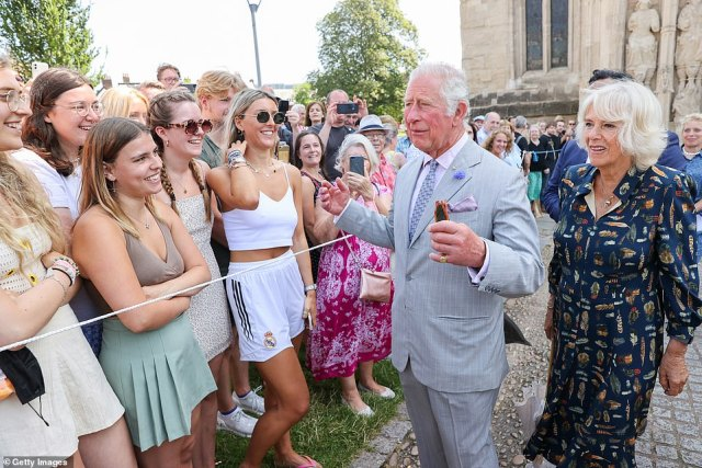 The couplewere all smiles as they chatted to crowds that had gathered for their visit and were greeted by lord lieutenant Julian Tagg