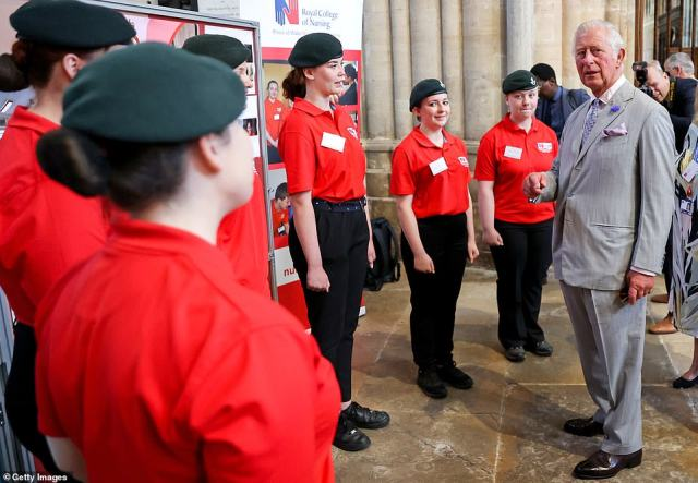 The Prince of Wales meets with young people dressed in uniform from Devon Nursing Cadets during a visit to Exeter Cathedral