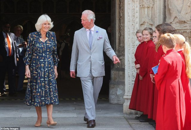 Camilla, Duchess of Cornwall and Prince Charles, Prince of Wales departing Exeter Cathedral, where choir members said goodbye outside