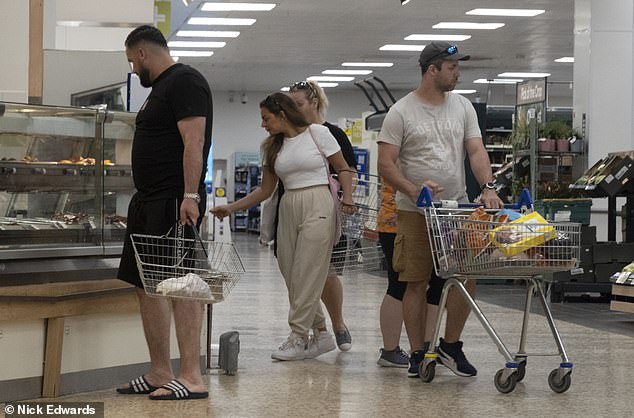 Shoppers in a London Tesco not wearing masks today. All the major supermarkets are asking customers to continue doing so