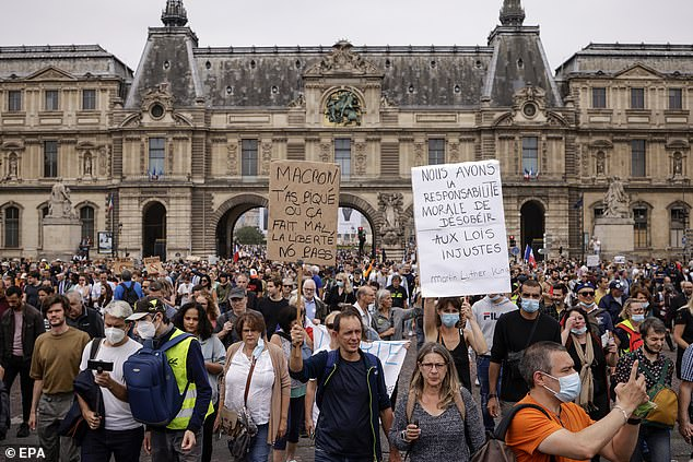 Macron's measures have angered many people who feel they infringe on individual freedoms. Pictured: Protesters in Paris on Saturday