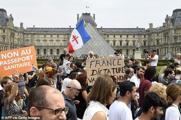 The announcement sparked protests across France, with large crowds gathering to demonstrate in 137 locations at the weekend. Pictured: A protest outside the Louvre in Paris on Saturday