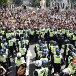 Anti-vax louts lob bottles at police during clash outside Parliament 💥👩💥