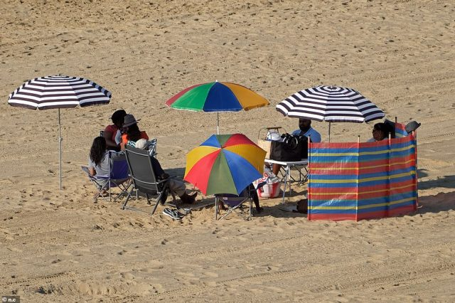 Beachgoers have already set up camp on Bournemout beach ready for another heatwave day