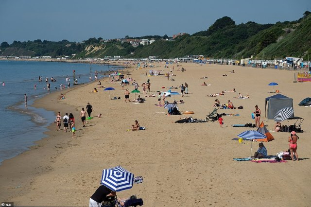 Sun lovers flock to the beach on the hottest day of the year so far on Bournemouth beach