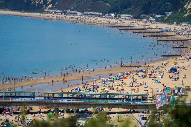 Bournemouth beach is packed with tourists and locals soaking up the scorching hot weather on what is the hottest day of the year