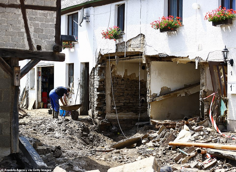 A man helps clear away rubble in the west German town ofSchuld, which was all-but destroyed in last week's flooding