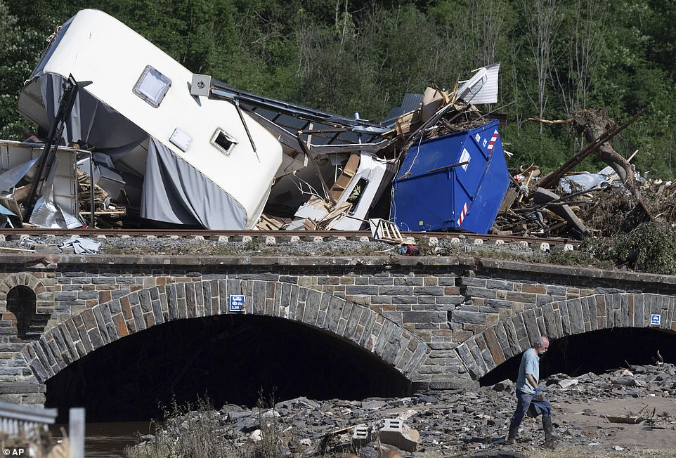 Caravans, cars and mobile homes that were swept away by the flood wave hang together on a bridge over the River Ahr, in Altenahr, western Germany