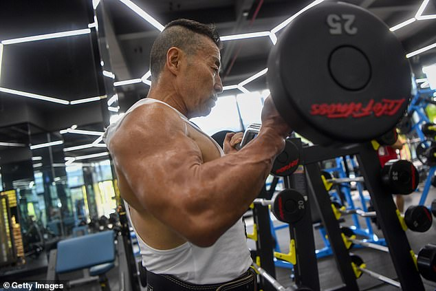 Yang Xinmin, a pioneer bodybuilder in China since the 1980s, continues to pump iron into his 70s