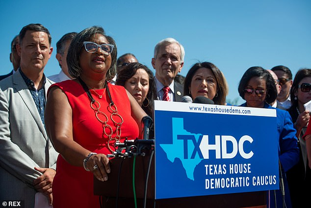 Rhetta Bowers, in red, confirmed on Monday that six of the 55 Texas Democrats have now tested positive for COVID-19, since fleeing to Washington DC a week ago on a private jet