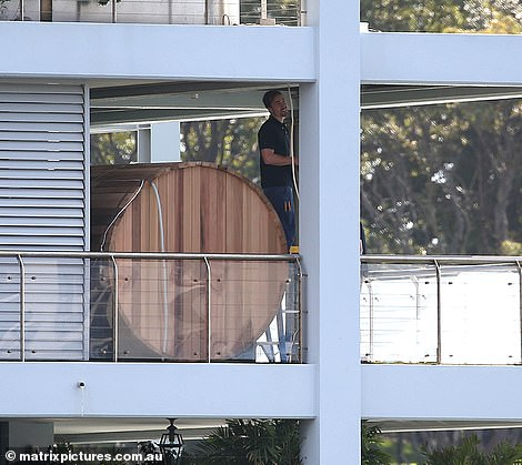 What will the neighbours say? Russell Crowe, 57, gave his $25million Finger Wharf apartment in Woolloomooloo a Hollywood-style upgrade last week by installing a Scandinavian wooden barrel sauna on the balcony