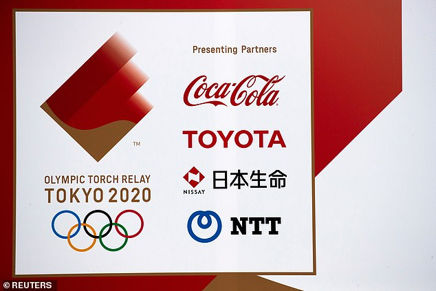 Amid fears over anger at the Games sponsors are loosening their ties, with Toyota (pictured on marketing), Panasonic, Fujitsu and NEC Group no longer attending the Opening Ceremony