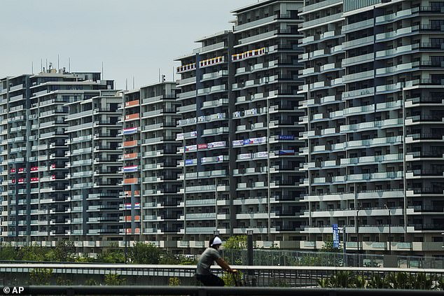 Ondrej Perusic, a volleyball player staying at Athletes' Village in Tokyo (pictured), was among 13 people liked to the Games who tested positive Monday - bringing total to 71