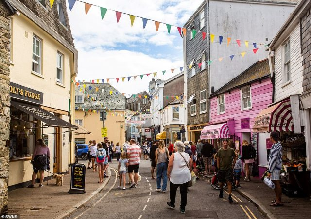 Kate Allen, owner of the luxury holiday lettings business Salcombe Finest, warned that the 'pingdemic' risks ruining staycations. Pictured is a street in Salcombe