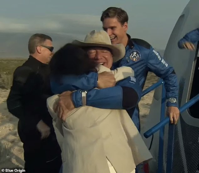 Bezos could be seen hugging his motherJacklyn (above) when he first emerged from the capsule before turning to his girlfriend