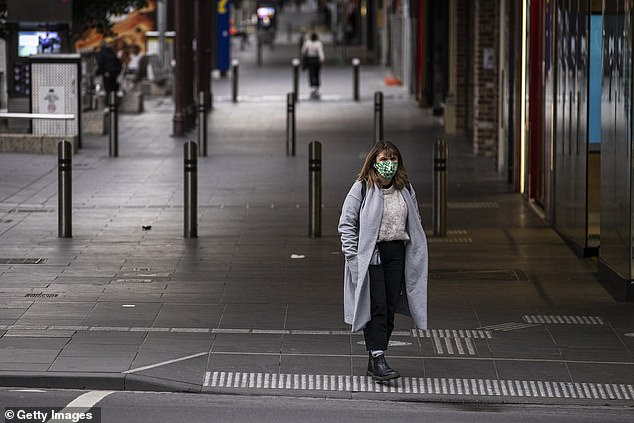 An extra week of lockdown in Victoria is unlikely to be enough to quash an outbreak of the Delta coronavirus variant, an epidemiologist says (pictured pedestrian in Melbourne)