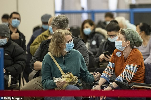 Victoria's lockdown was scheduled to end at midnight but has been extended for another seven days until midnight July 27 (pictured Melbourne residents wait to get a Covid vaccine)