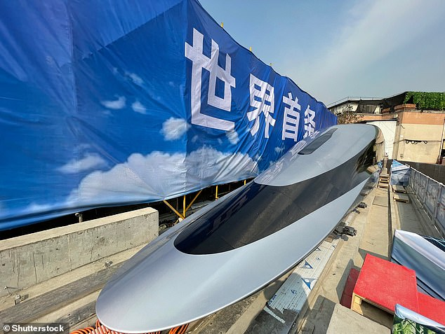 A prototype of a high-temperature superconducting maglev train, dubbed as the 'super bullet maglev train', is pictured at its debut ceremony in China's Southwest Jiaotong University on Wednesday