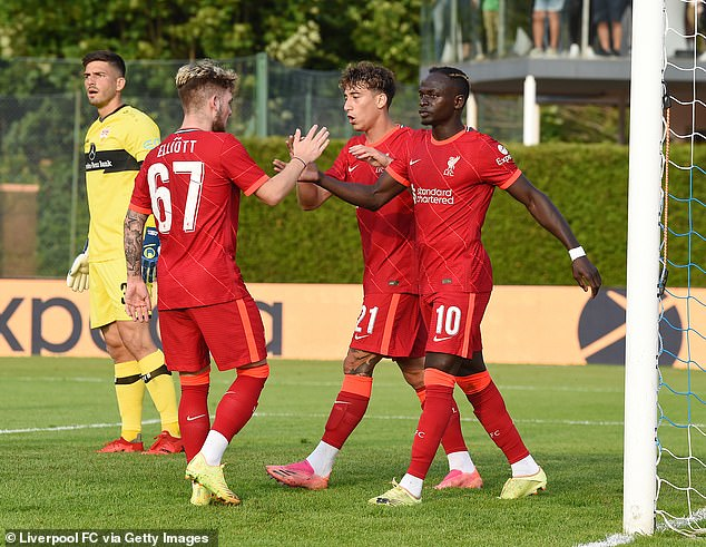 Sadio Mane (right) scored for the Reds in their 1-1 draw with Bundesliga side Stuttgart