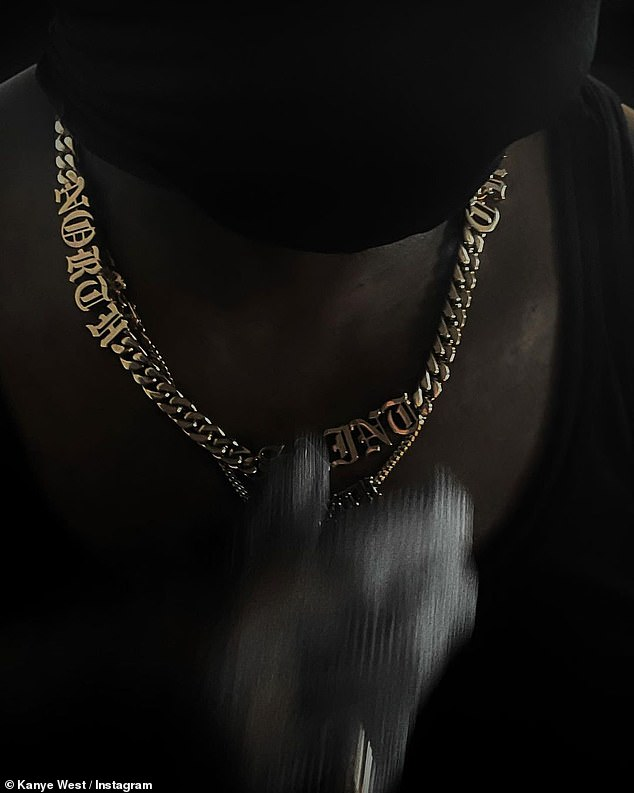 Family: The rapper showed off gold chains with his four children's names ahead of his new album release