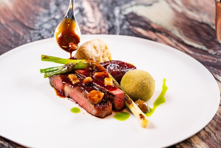 In the contemporary Adam's dining room guests enjoy modern British cuisine (above)