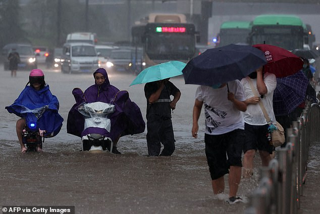Rains brought the city ofZhengzhou to a standstill during Wednesday evening's rush hour, before waters found their way into the subway and flooded it - killing at least 12