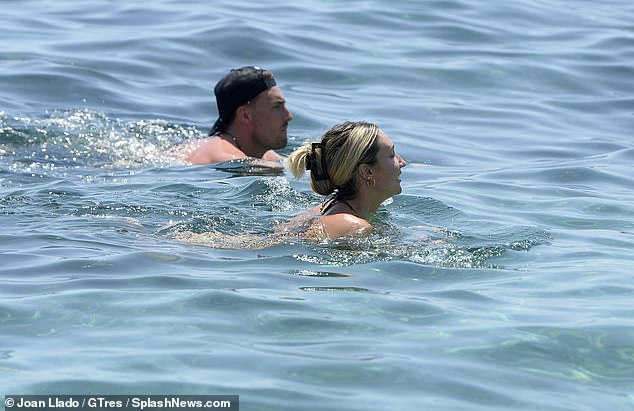 Going swimmingly: The couple enjoyed a leisurely swim side-by-side
