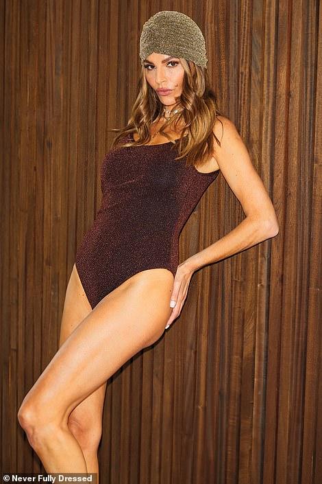 Work it: The fashionista added her own stylish twists to the swimwear pieces