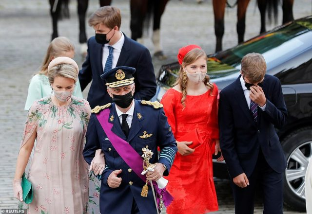 Prince Gabriel (behind) checked on his younger sister Princess Elenore as the royal family made their way inside the cathedral
