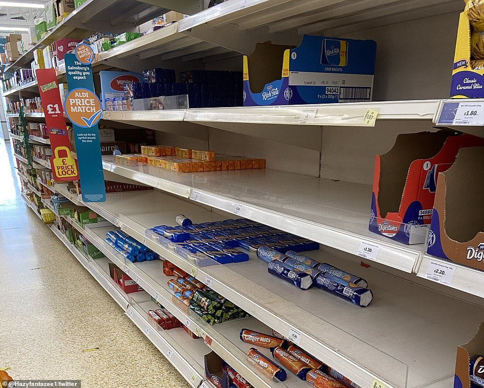 A shortage of HGV drivers in Britain - caused by a combination of Brexit and the pandemic - is affecting some businesses. Pictured is a photo of shelves in a Sainsbury's this week