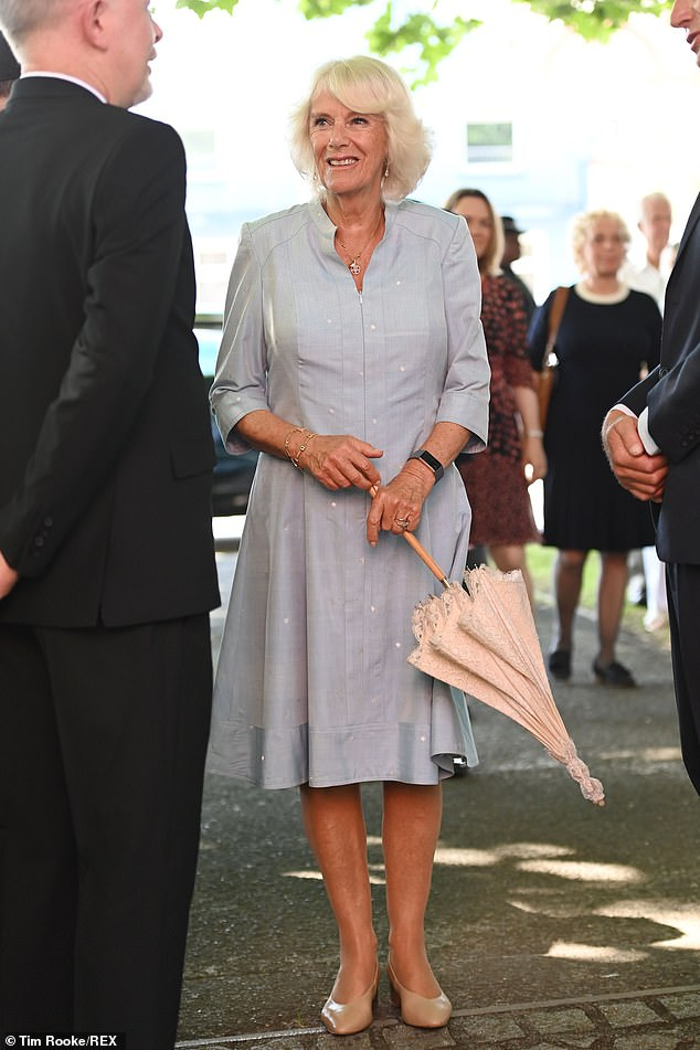 The Duchess of Cornwall was all smiles as she went mask-free and joined Prince Charles on a visit to The Burton at Bideford to celebrate the art gallery's 70th anniversary today - the final day of their tour of the South West
