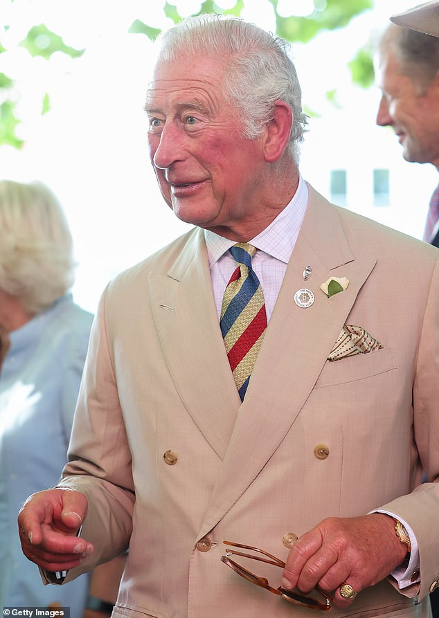 Prince Charles could be seen clutching a pair of sunglasses as he arrived to view an exhibition of archive photographs by local photographer James Ravilious from the Beaford Archives