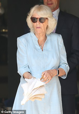 The royal was also seen holding a chic umbrella to protect her from the sun's rays
