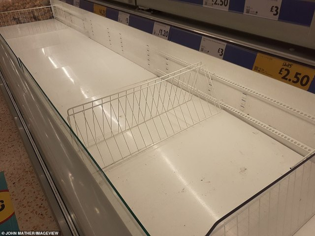A frozen section at a Morrisons in Manchester is seen cleared of products in a photo taken this afternoon