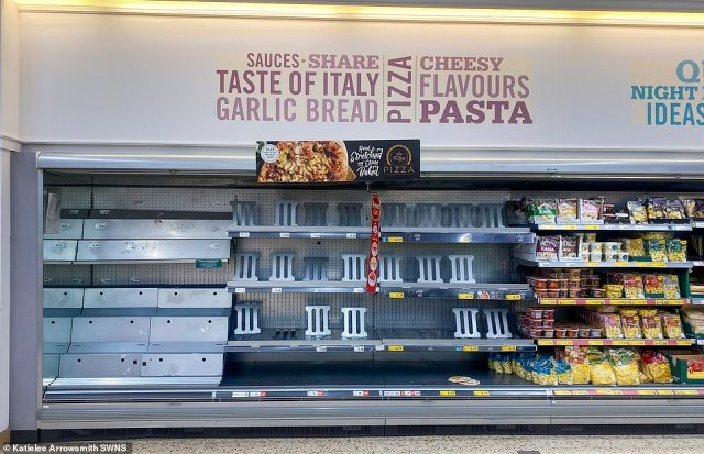 There have been reports that the government may excuse supermarket workers and HGV drivers from having to self-isolate if they are pinged by the Covid app. Pictured: Empty pizza shelves at a Morrisons in Granton, Edinburgh