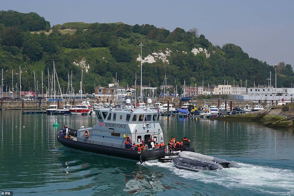 A group of people thought to be migrants are brought in to Dover onboard a border force boat following a small boat incident