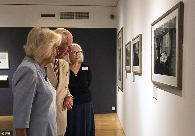 The Prince of Wales and the Duchess of Cornwall took great interest in the artwork as they took a tour of the exhibition