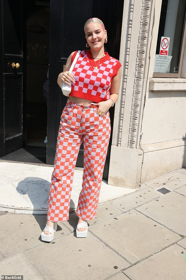 Gorgeous:Anne-Marie was a vision in a pink checked sweater vest and jeans as she left the Global Radio studios in London on Wednesday