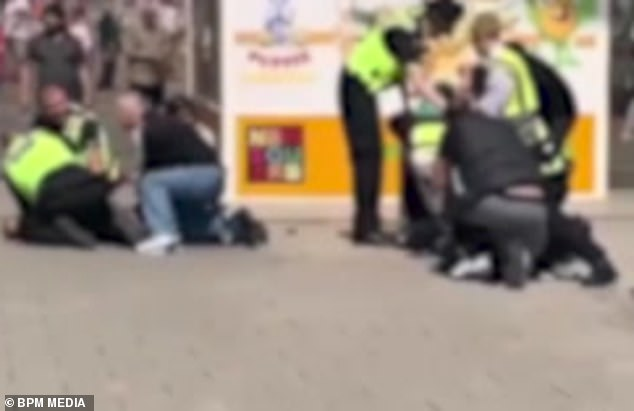 Police put in place a dispersal order allowing them to search passers-by for weapons following the arrests (pictured)