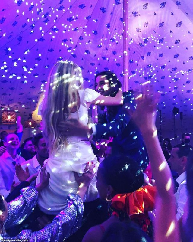 Dancing in the moonlight! Lady Clara and Oscar were lifted onto their friends' shoulders as they partied the night away in the tent. The tent was set up with a DJ booth, a dance floor and was decorated with rattan lanterns hung from the canopy