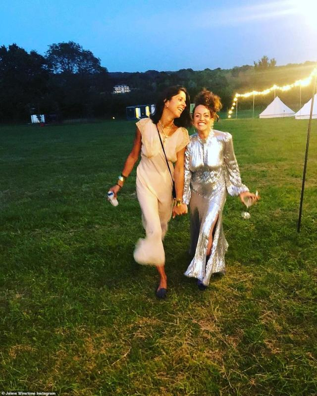 Getting ready to party! Jaime Winstone shared this photo of her strolling through the grounds with a wedding guest. Festoon lights were strung across the fields to mark the way
