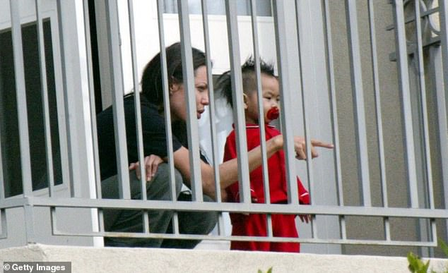 Jolie plays with Maddox on a hotel balcony on December 30, 2002 in California 2002