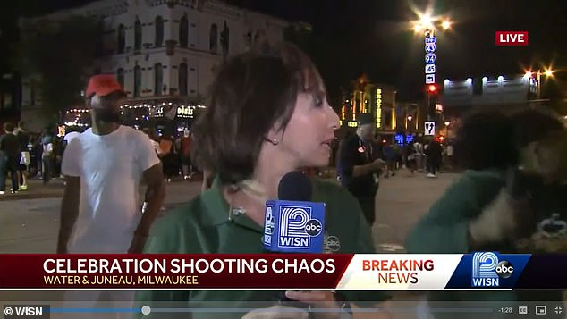 A WISN reporter was broadcasting live when a barrage of gunfire erupted nearby. This screenshot captures her reaction to the sound of gunshots