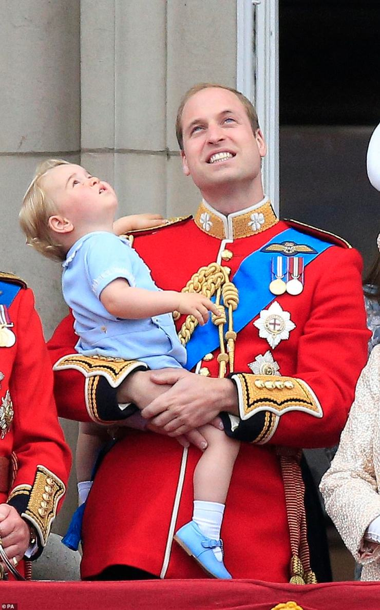 Prince George - the eldest son of the Duke and Duchess of Cambridge - donned a baby blue ensemble as he was pictured in his father Prince William's arms during his second Trooping the Colour, on the balcony of Buckingham Palace, on 13 June 2015