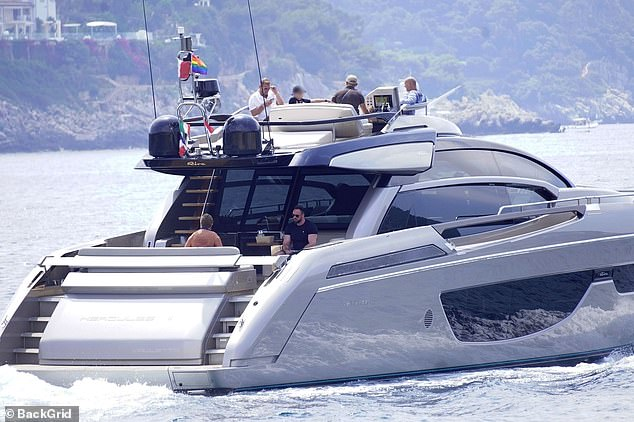 Luxury: The singer and his husband arrived at the port with their entourage before boarding the yacht, named Hercules II
