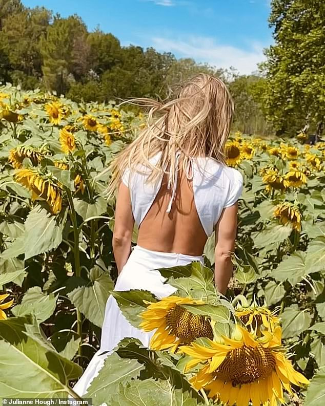 Luscious locks: Her beautiful golden hair remained free-flowing and fell onto both her chest and her backside