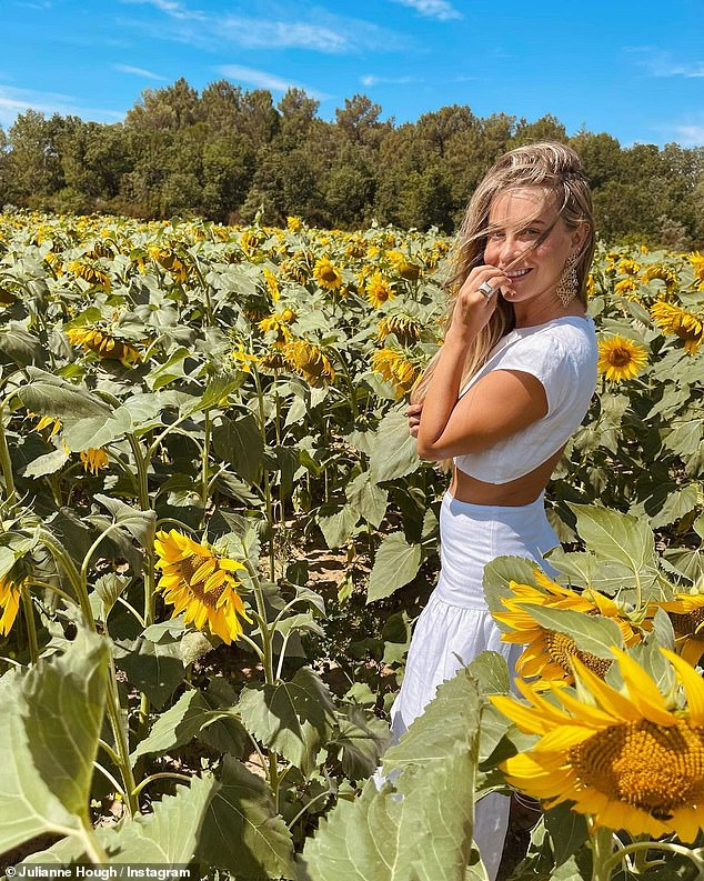 Special day: Julianne Hough shared a photo and a video of herself frolicking in a sunflower-filled field to her Instagram account on the day after her 33rd birthday