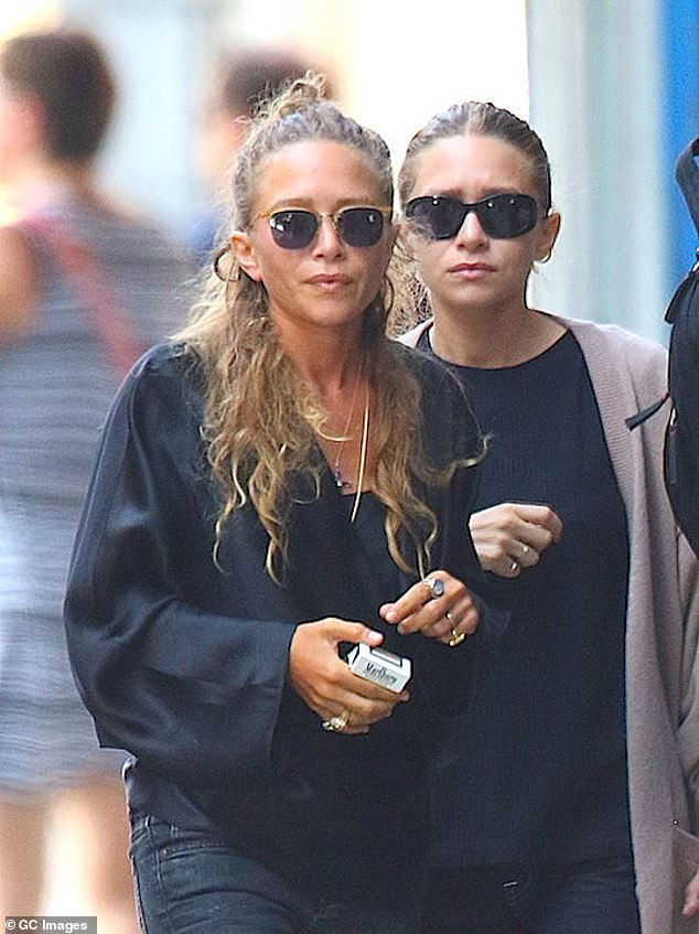 The Olsen twins (pictured in 2015) wear a chic city uniform consisting of black clothes and sunglasses