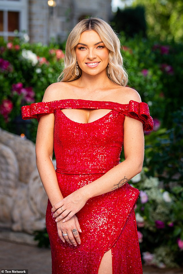 Peek-a-boob!Tahnee Leeson was determined to turn heads with her bedazzled red evening gown, which featured a 'window' style neckline that drew attention squarely to her cleavage
